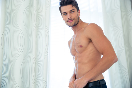 nude male body: Portrait of a happy man with perfect body