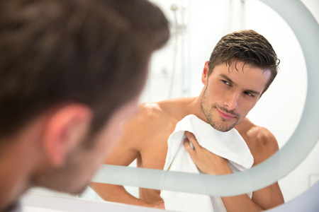 bath and body: Portrait of a man washing in bathroom