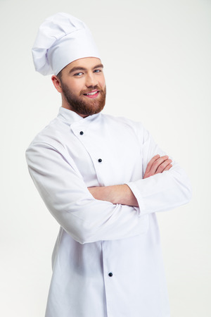 one young man: Portrait of a happy male chef cook standing with arms folded isolated on a white background