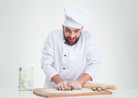 preparing dough: Portrait of a baker preparing dough for pastry isolated on a white background