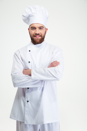 Portrait of a cheerful male chef cook standing with arms folded isolated on a white background