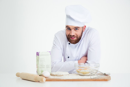 pastries: Portrait of a smiling male chef cook baking isolated on a white background Stock Photo