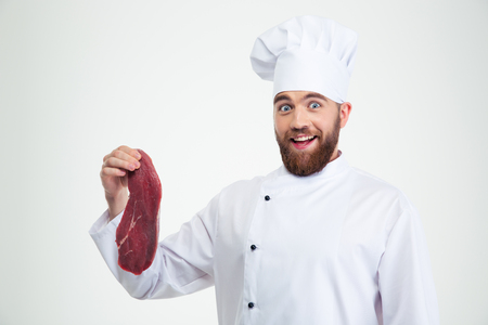 teethy: Portrait of a happy male chef cook holding meat isolated on a white background Stock Photo