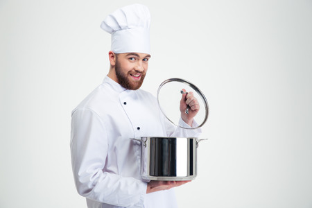 Portrait of a smiling male chef cook holding pan isolated on a white background
