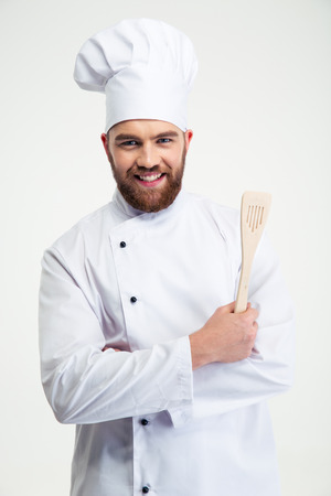 Portrait of a smiling chef cook holding spoon isolated on a white background