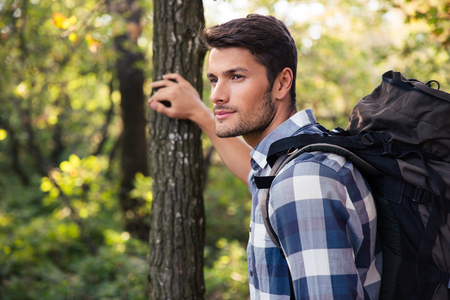 traveler: Portrait of a young man traveling in forest Stock Photo