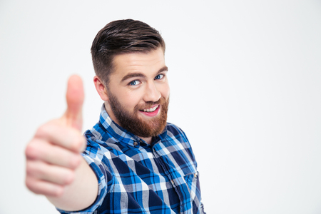 Portrait of a smiling casual man showing thumb up isolated on a white background Standard-Bild