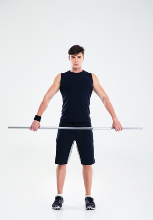 well build: Full length portrait of a handsome fitness man workout with barbell isolated on a white background Stock Photo