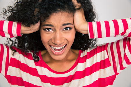 Portrait of afro american woman shouting isolated on a white background