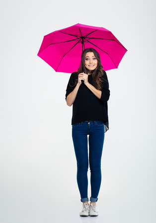 pretty lady: Full length portrait of a smiling woman standing under umbrella isolated on a white background