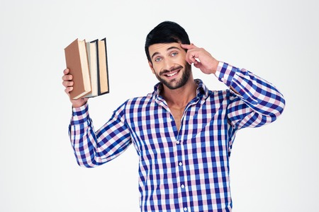 attractive people: Portrait of a cheerful young man holding books isolated on a white background Stock Photo
