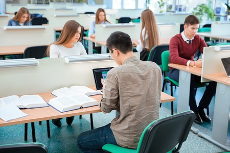 reading and writing: Students are reading, writing and learning sitting at the desks