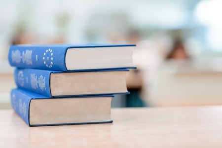 univercity: Three blue books are lying on the table Stock Photo