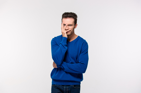 disappoint: Portrait of upset man looking at camera isolated on a white background