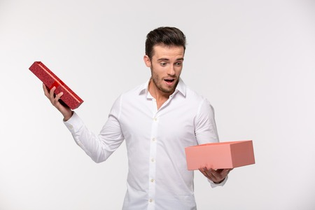 men shirt: Portrait of a businessman opening gift box isolated on a white background