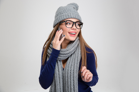 mouth cloth: Portrait of a smiling woman talking on the phone and looking away isolated on a white background