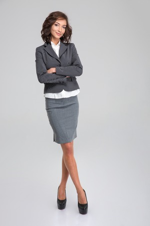 full lenght: Full lenght portrait of business woman on white background Stock Photo