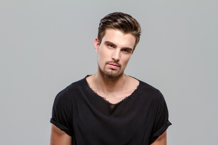 indifferent: Portrait of indifferent young handsome man in black t-shirt Stock Photo