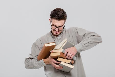 univercity: Unconfident handsome student in glasses droping books