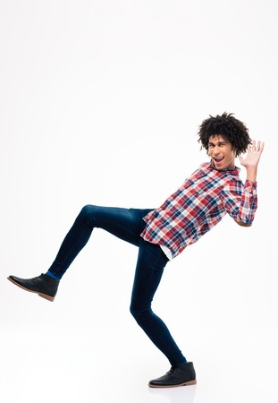 afro man: Full length portrait of afro american man falling isolated on a white background