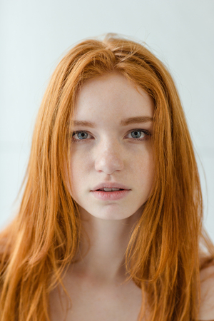 prettiness: Portrait of a beautiful redhead woman looking at camera Stock Photo