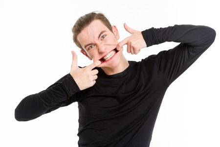 Funny man stretching his mouth isolated on a white background