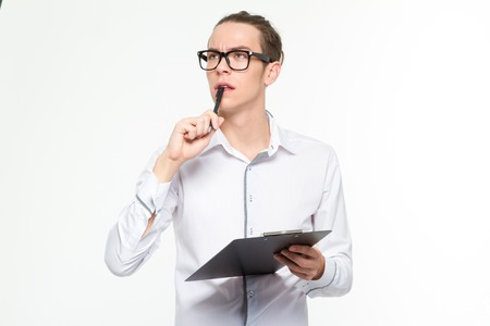 signing authority: Portrait of a pensive man holding clipboard isolated on a white background