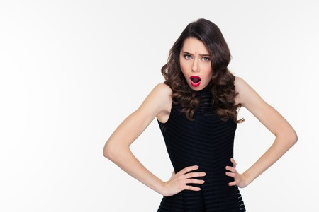 annoy: Shoked disturbed pretty young woman with bright makeup in retro style in black dress isolated over white background