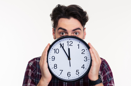 mouth cloth: Portrait of a young man covering her face with wall clock isolated on a white background