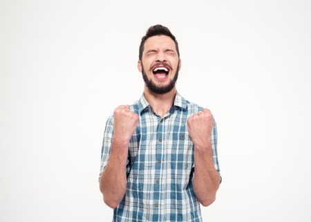 excitement: Excited elated happy bearded young male in checkered shirt celebrating success over white background
