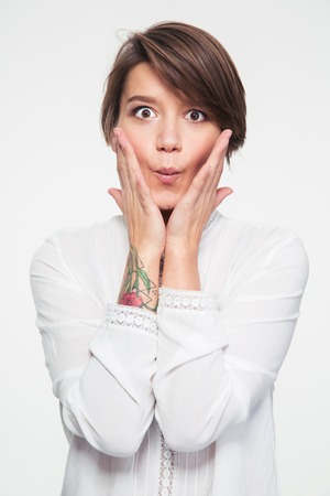 short haircut: Portrait of playful amusing young woman with short haircut making funny face over white background Stock Photo
