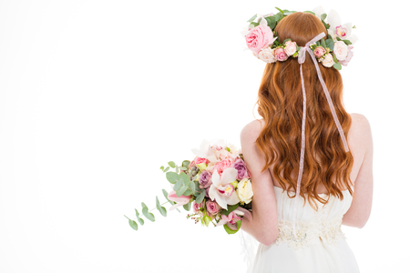skiny: Back view portrait of a redhead woman standing with flowers isolated on a white background