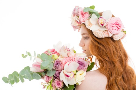 Back view portrait of a redhead woman standing with flowers isolated on a white background