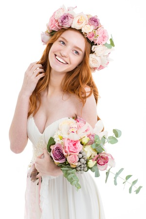 flower head: Portrait of a happy redhead woman holding flowers isolated on white background
