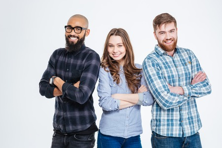 male arm: Multiethnic group of three confident smiling students standing