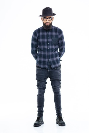 hands behind back: Full length of attractive serious african american man with beard standing with hands behind back