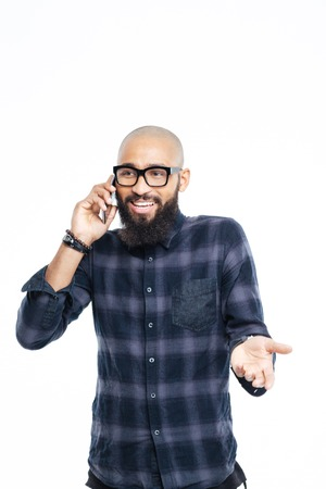 spontaneous expression: Happy afro american man talking on the phone isolated on a white background Stock Photo