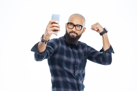 hairless: Handsome hairless african american man with beard showing biceps and making selfie