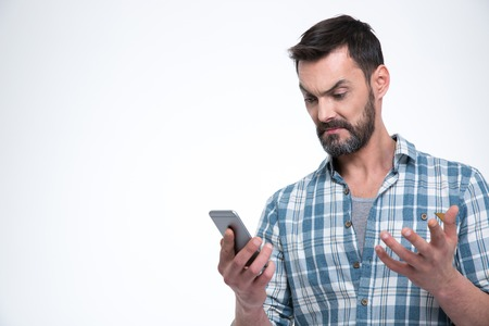 perplex: Angry man holding smartphone isolated on a white background