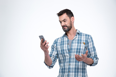 perplex: Man holding smartphone isolated on a white background Stock Photo