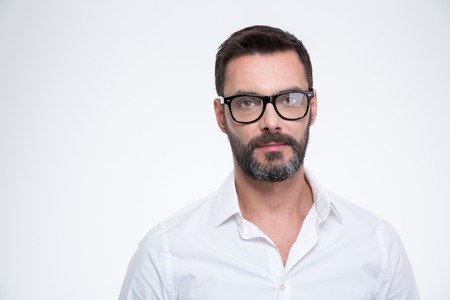 white shirt: Handsome businessman in glasses looking at camera isolated on a white background Stock Photo