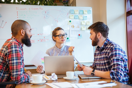 beard woman: Group of serious young people working on business meeting together