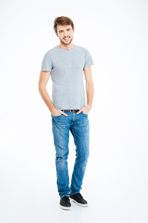 staring at the camera man: Full length portrait of a happy casual man standing isolated on a white background Stock Photo