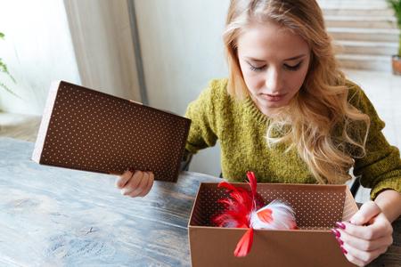 opening gift: Beautiful woman opening gift box
