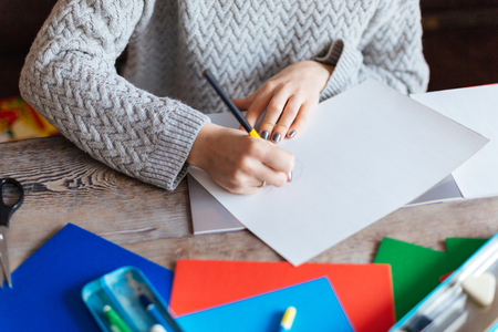 cropped: Cropped image of a woman drawing on paper Stock Photo