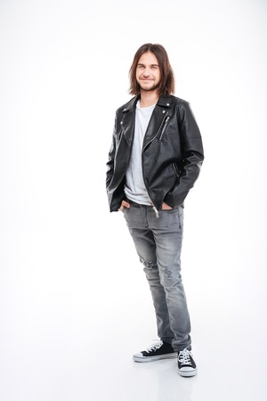 full metal jacket: Full length portrait of attractive smiling young man with long hair in black leather jacket over white background