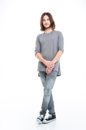 full lenght: Full lenght of handsome young man with long hair standing over white background