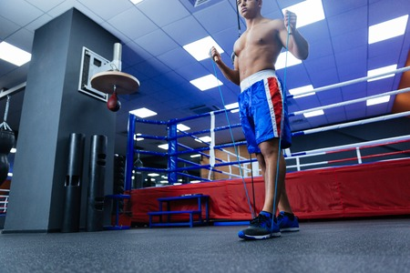muscle toning: Boxer warming up with skipping rope