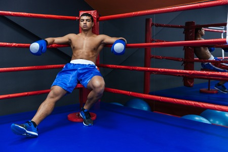 barechested: Boxer resting in boxer ring