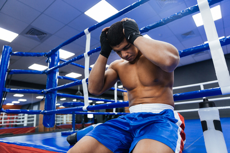 barechested: Handsome male boxer resting in gym